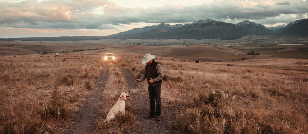 Onda Premium Hemp CBD, Founder, Stephen Smith on his ranch with his dog