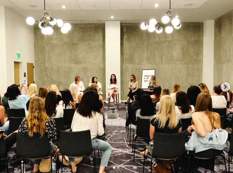 Holisticism founder Michelle Pellizzon on a panel at an event