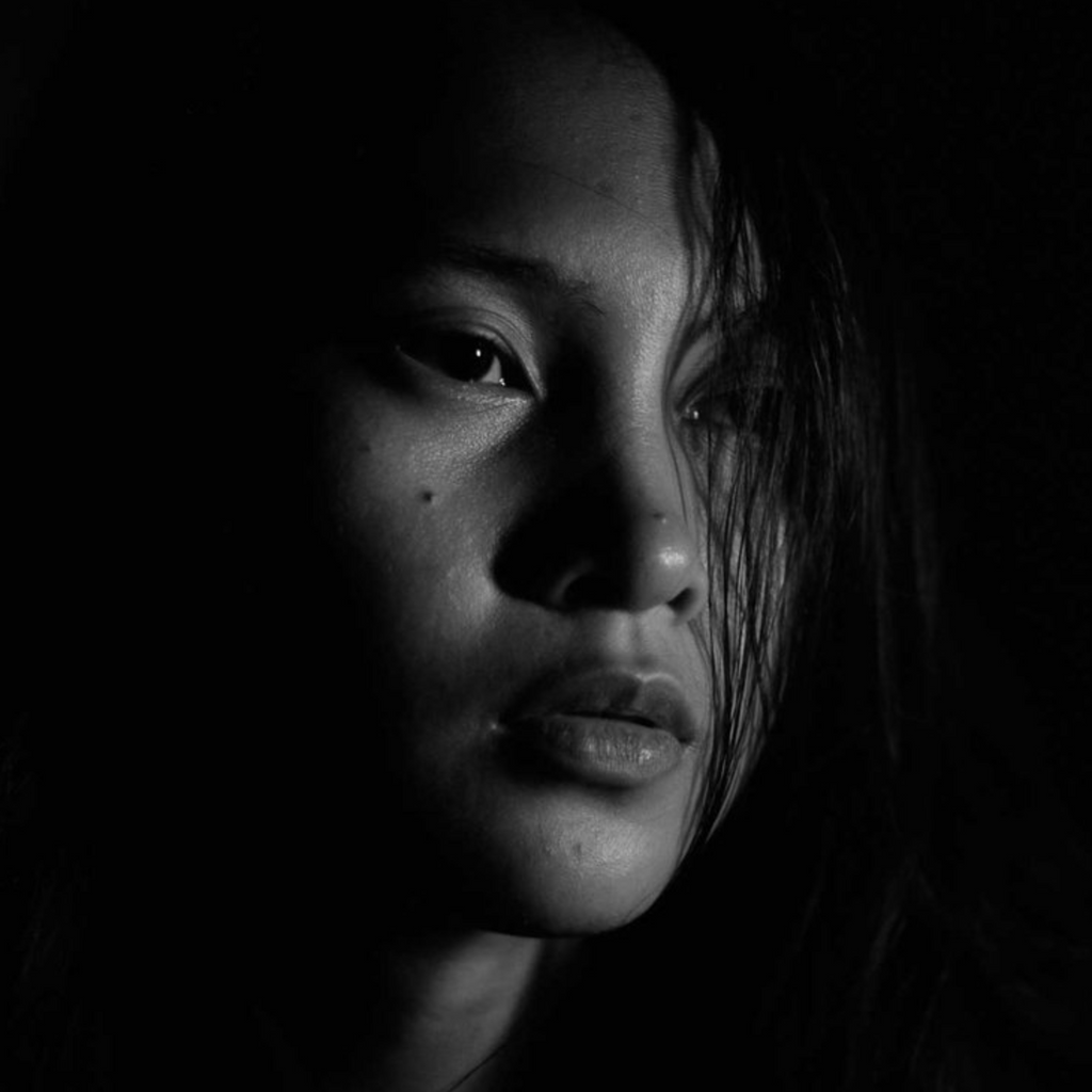 Black and white portrait of a girl shot by Eyre June Bustamante