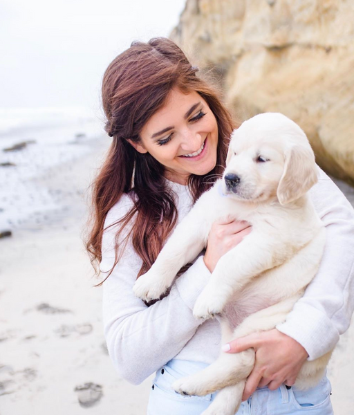 Dominique Astorino, Svn Space contributor with her white lab on a beach