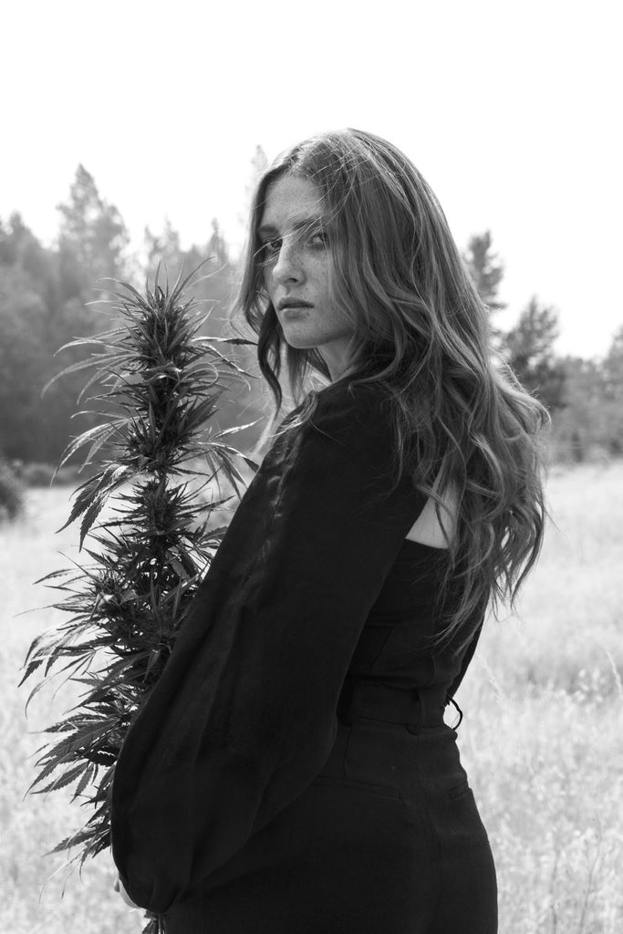 Model wearing hemp Mara Hoffman top and skirt in hemp field for Svn Space print issue 001