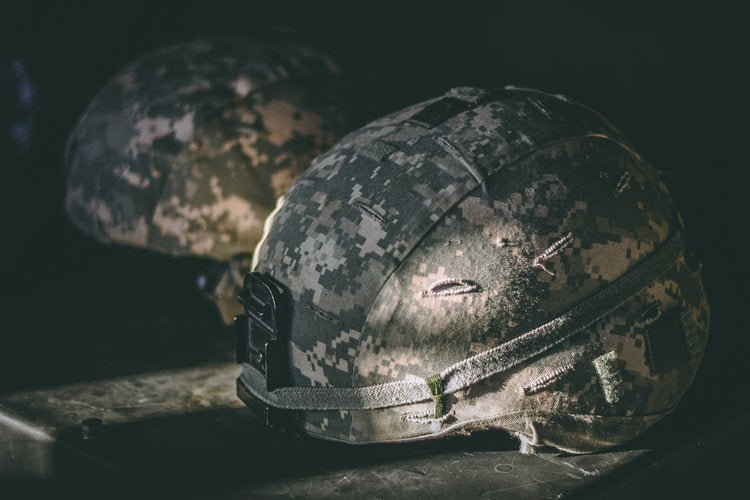 Military helmet laying on table
