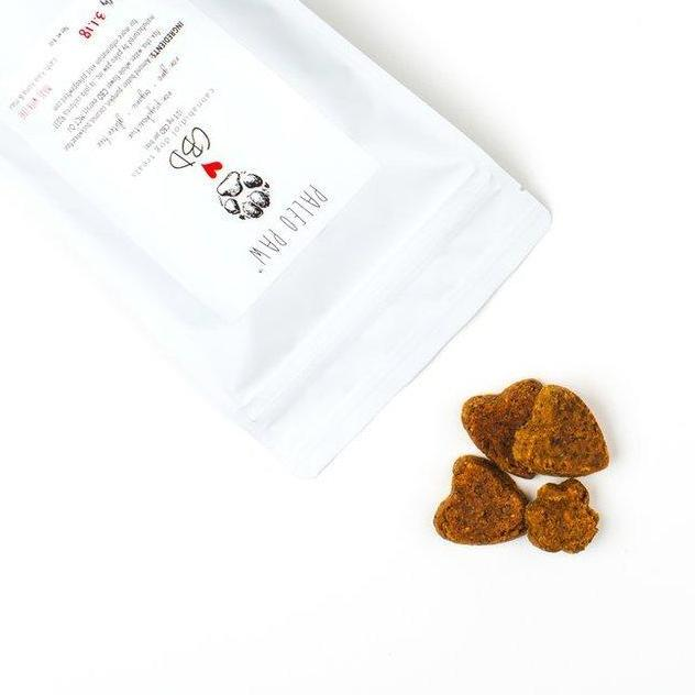 Paleo Paw CBD Pet Treats opened view with treats by Svn Space.