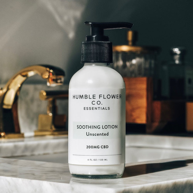 Humble Flower Co. CBD Unscented Lotion Front of Bottle lifestyle