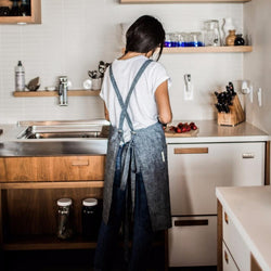 Back of girl wearing Cross-Back Hemp Apron by Portland Apron Co, Svn Space.