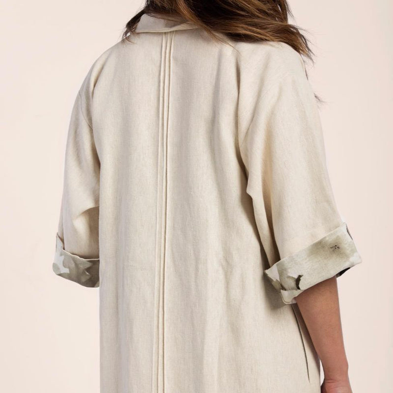 Back side of girl wearing Arraei Collective Hemp Trench Coat