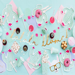Boho Llama party decorations with gold llama garland, mint party cups with gold details, mint coloured cactus shaped plate with hot pink details, straws and napkins.
