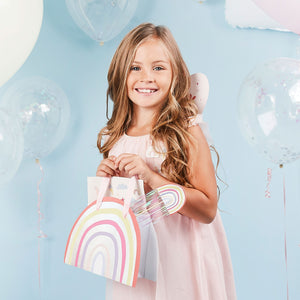 Image of girl with rainbow party bag & rainbow wand.
