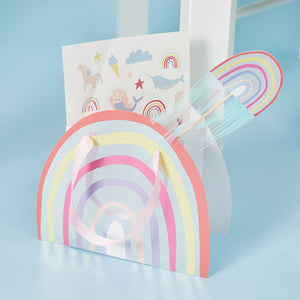 Rainbow party bag and rainbow wand.