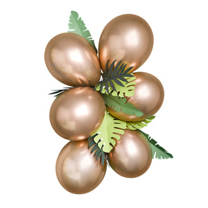 Six bronze balloons grouped with green leaf decorations for a jungle themed birthday party.