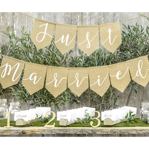 Neutral wedding burlap bunting with white print with the words just married printed
