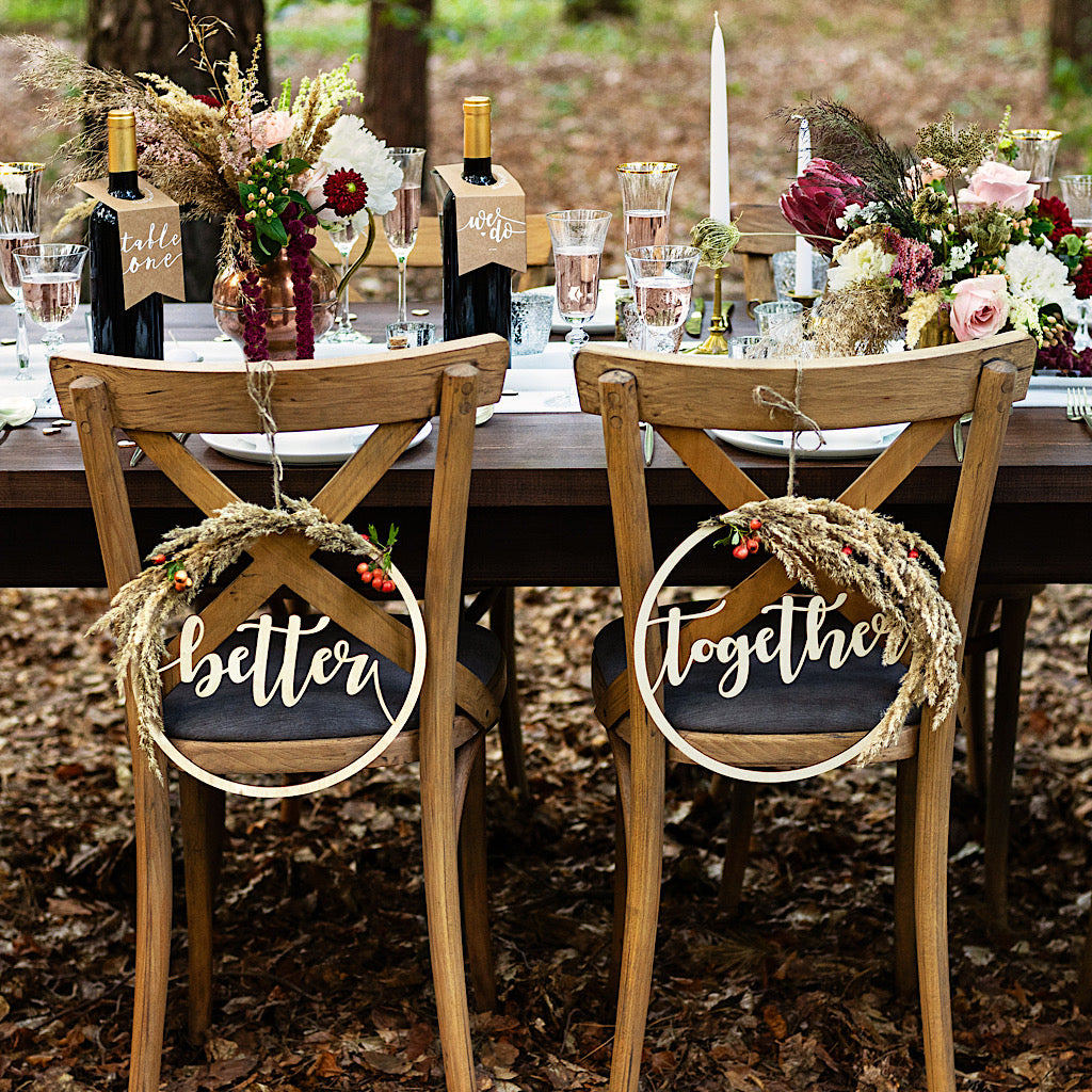 Kraft paper wedding bottle hangers with the words we do printed in white
