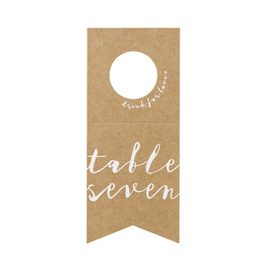 wedding bottle hanger table numbers in brown kraft paper with white descriptive writing