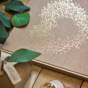 wedding guest book in gold foil and brown kraft paper