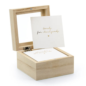 Wedding advice cards in white with gold foil words for newlyweds in a natural wooden box with a clear glass lid