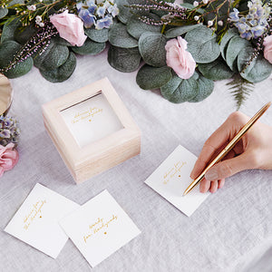 100 White wedding advice cards with the words printed 'words for newlyweds' in gold foil. Comes in a natural wooden box with a clear glass top