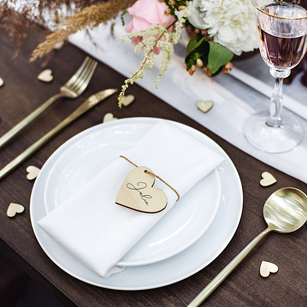 Natural wooden heart shaped wedding place tags with linen brown string