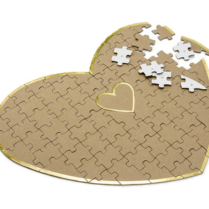 heart shaped puzzle guest book for your wedding day in brown kraft paper with gold trim detail for your guest to write on