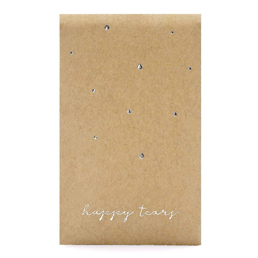 pack of 3 tissues for your wedding guests with the words happy tears in silver foil writing on kraft brown paper pack