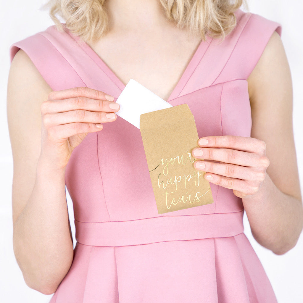 Your happy tears pack of wedding tissues in gold foil writing on a brown kraft paper pack
