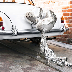 Wedding day silver car decoration kit with three heart balloons, silver tassels and silver cans to decorate the back of the car