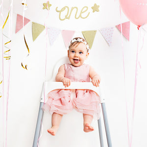 first birthday Gold sparkle banner with the words one cut out and gold stars either side