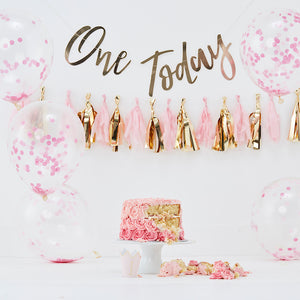 pink first birthday cake smash decorations kit. Includes one today gold banner, pink and gold tassle garland, pink confetti balloons and 1 gold foil princess crown hat