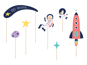 Space party themed cake topper with planets, rocket, star and astronaut.