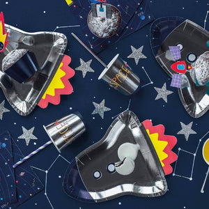 Silver rocket shaped paper party plate and silver paper party cups space themed.