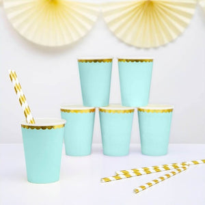 Mint green paper party cups with scalloped gold foil detail.