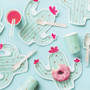 Mint green cactus shaped plates with gold detailing and pink flowers.
