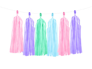 Hanging pastel tissue paper tassels, in purple, green, pink and blue