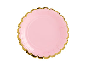 Pale pink paper party plate with gold scalloped edge detail.