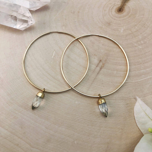 large gold hoop earrings with tiny quartz crystals
