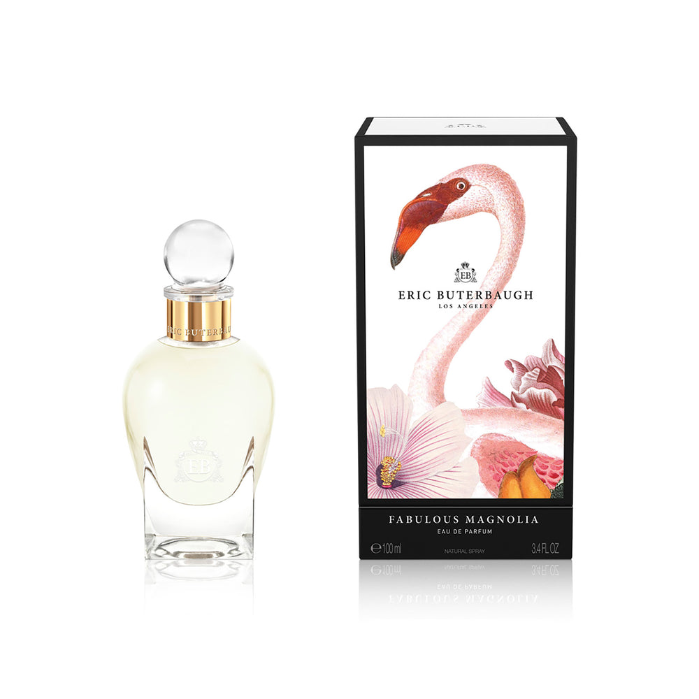 100 ml bottle, with transparent glass and yellowish perfum. Spherical cap with gold band. By his side the box, with pink flamingo and flowers illustration, within a black border. Fabulous Magnolia, a fragrance by Eric Butherbaugh.