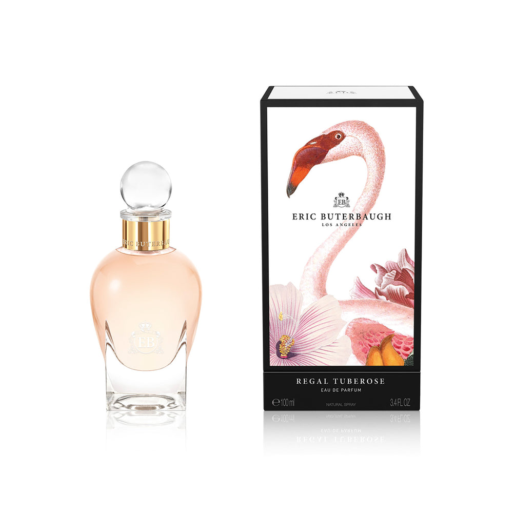 100 ml bottle, with transparent glass and orangey perfum. Spherical cap with gold band. By his side the box, with pink flamingo and flowers illustration, within a black border. Regal Tuberose, a fragrance by Eric Butherbaugh.