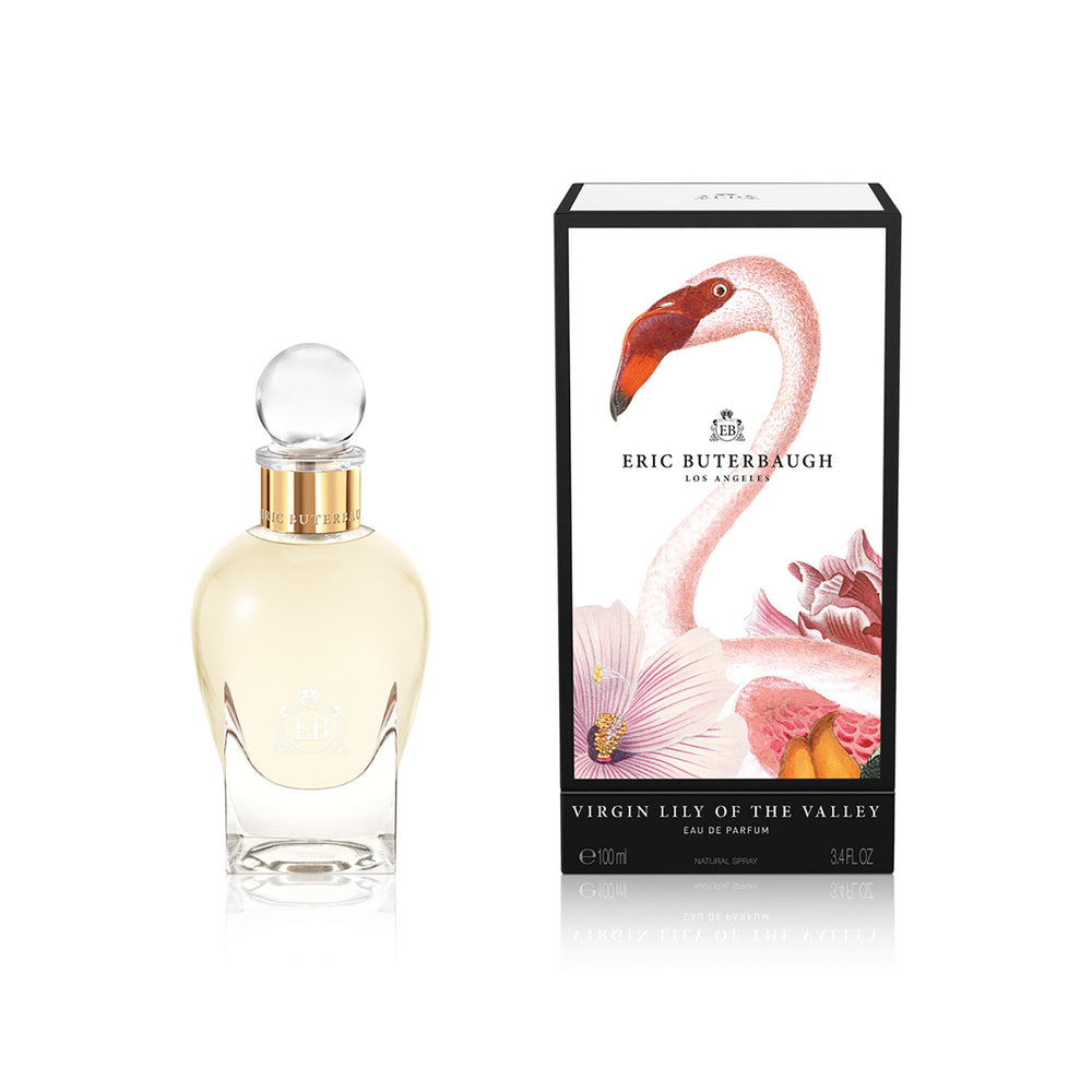 100 ml bottle, with transparent glass and yellowish perfum. Spherical cap with gold band. By his side the box, with pink flamingo and flowers illustration, within a black border. Virgin Lily of the Valley, a fragrance by Eric Butherbaugh.