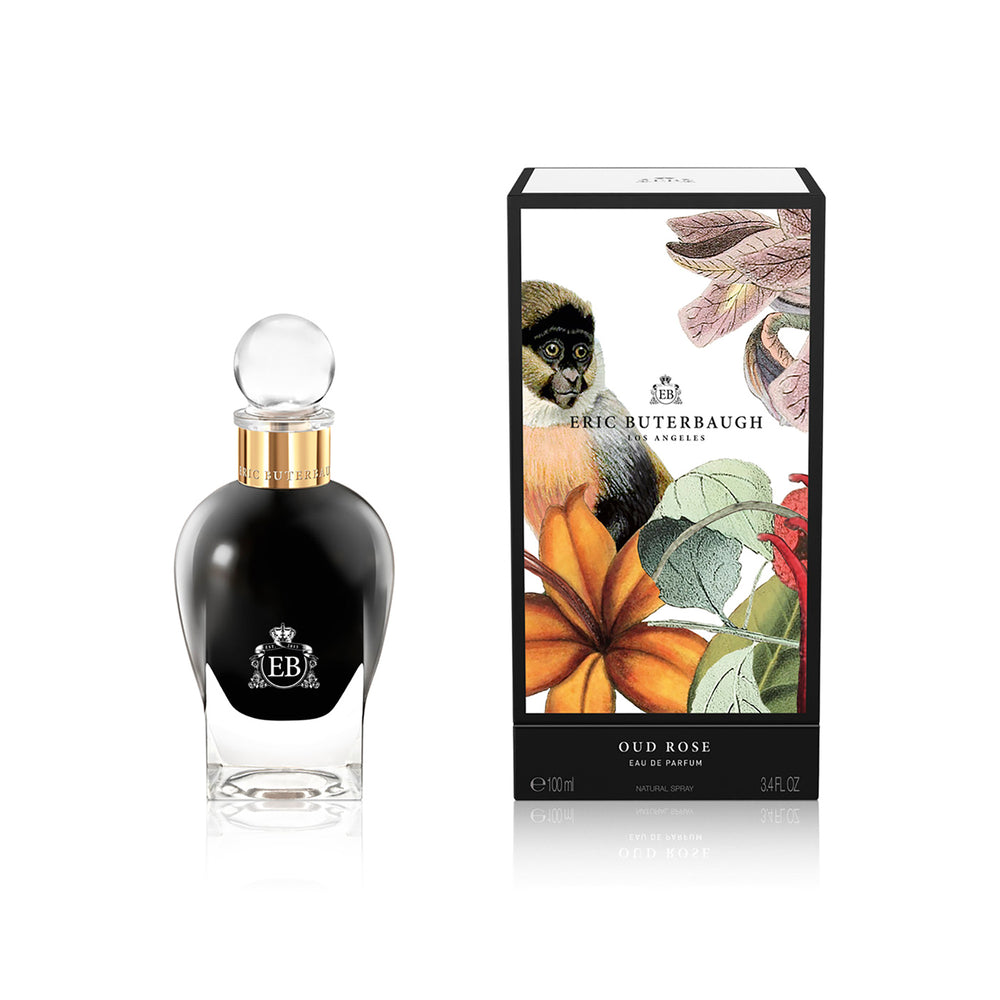 100 ml bottle, with  black opaque glass. Spherical cap with gold band. By his side the box, with monkey and plants illustration, within a black border. Oud Rose, a fragrance by Eric Butherbaugh.