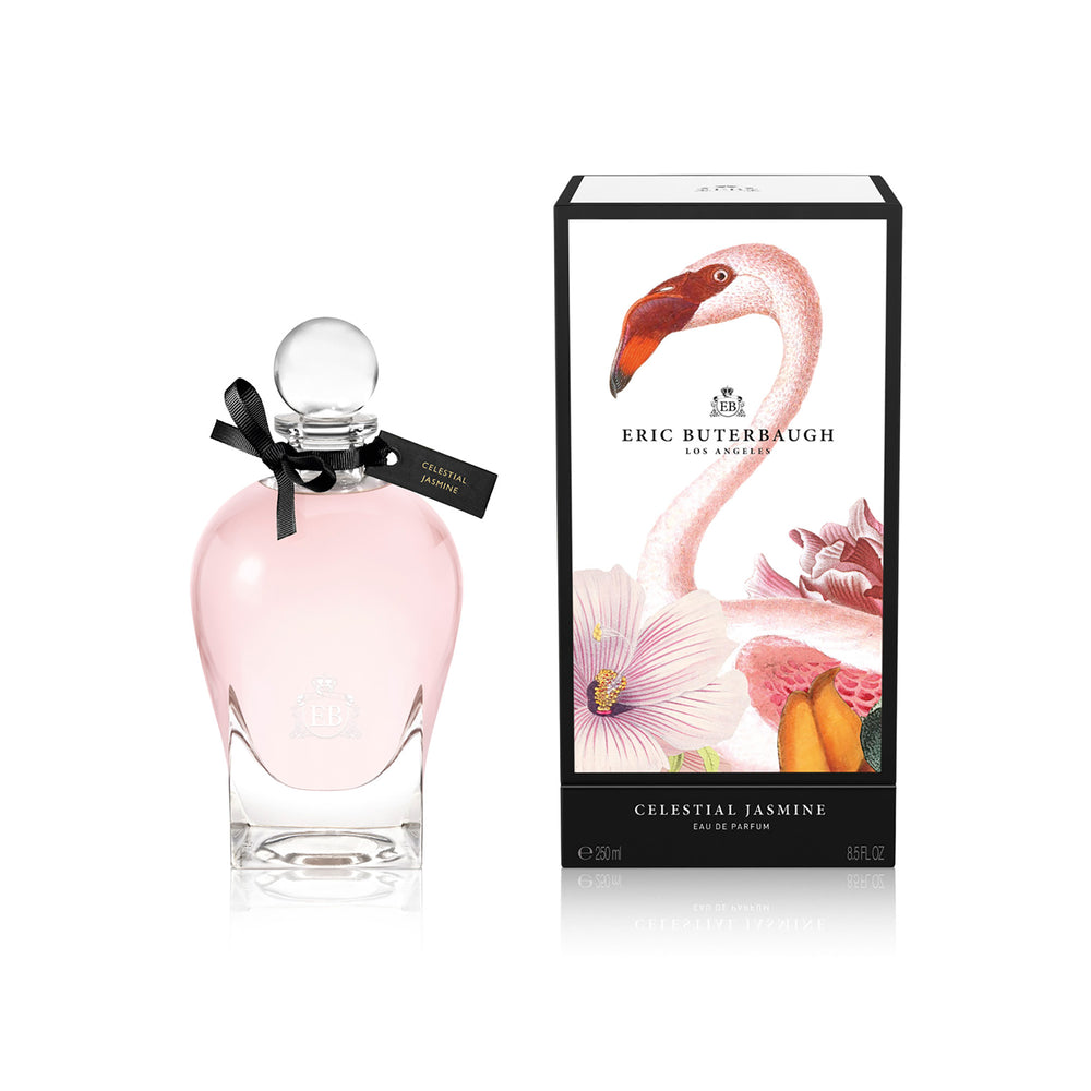 250 ml bottle, with transparent glass and pinkish perfum. Spherical cap with black ribbon. By his side the box, with pink flamingo and flowers illustration, within a black border. Celestial Jasmine, a fragrance by Eric Butherbaugh.