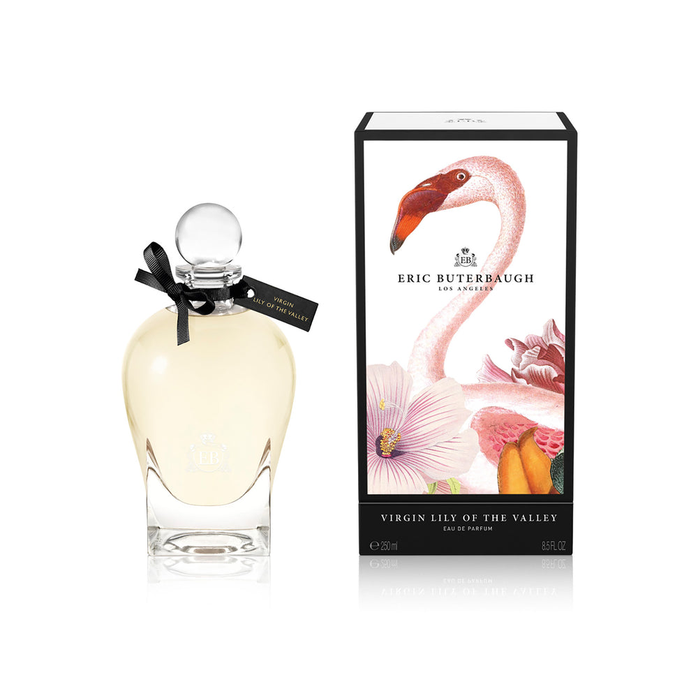 250 ml bottle, with transparent glass and yellowish perfum. Spherical cap with black ribbon. By his side the box, with pink flamingo and flowers illustration, within a black border. Virgin Lily of the Valley, a fragrance by Eric Butherbaugh.