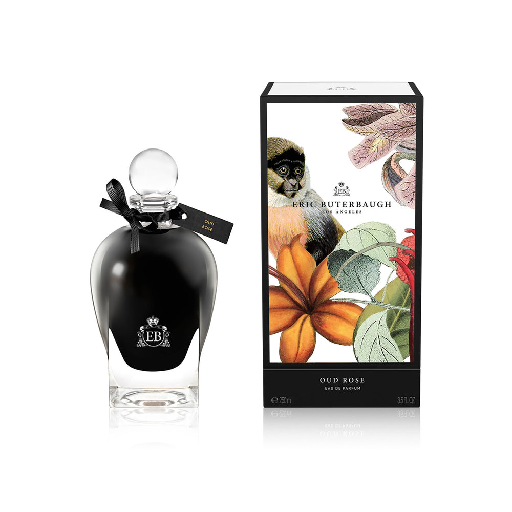 250 ml bottle, with  black opaque glass. Spherical cap with black ribbon. By his side the box, with monkey and plants illustration, within a black border. Oud Rose, a fragrance by Eric Butherbaugh.