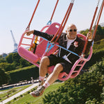 Eric Buterbaugh having fun in a pink cabin of a flying chairs atraction in Paris.