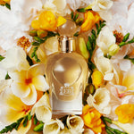 A 100 ml Fabulous Magnolia bottle lying on a bed of magnolias.