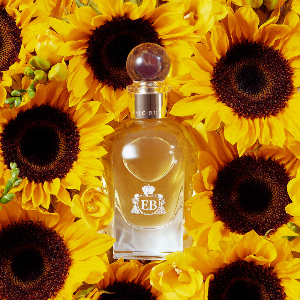 A 100 ml Nick´s Sunflower bottle lying on a bed of sunflowers.