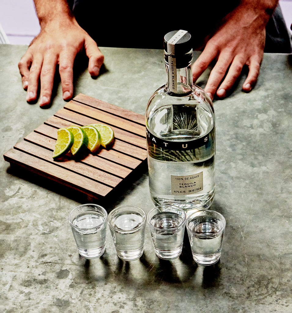 Hiatus tequila with shots in front of the bottle.