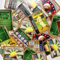Easy card games - The Beginner Collection from Famous Games Co. - Baseball and Tennis (photo: scattered cards)