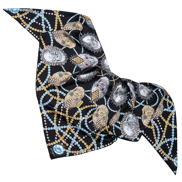 street-art-silk-scarf-by mocomoco-berlin-motif-london-artist-uberfubs-motif-sculls-and-jewellery-black-gold-silver-140x140cm-lying-folded-in-bird-wing-shape-2