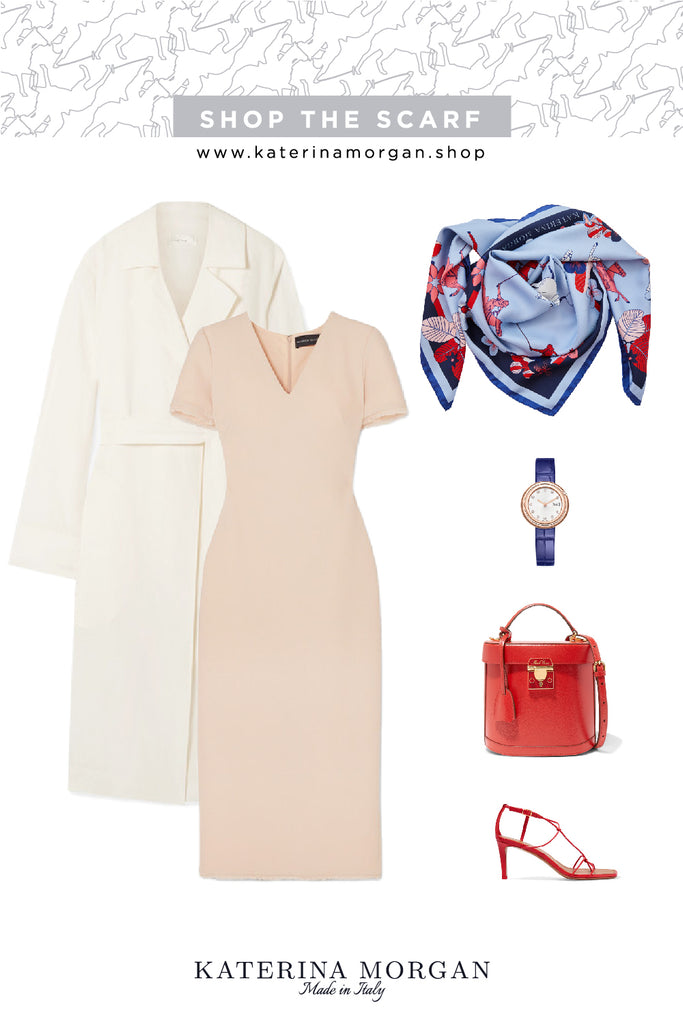 Neutral dress with red and blue accessories