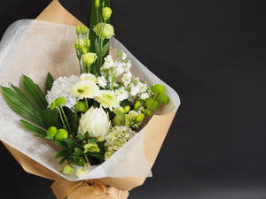 Green and White Flower bouquet for Mother's Day includes seasonal flowers