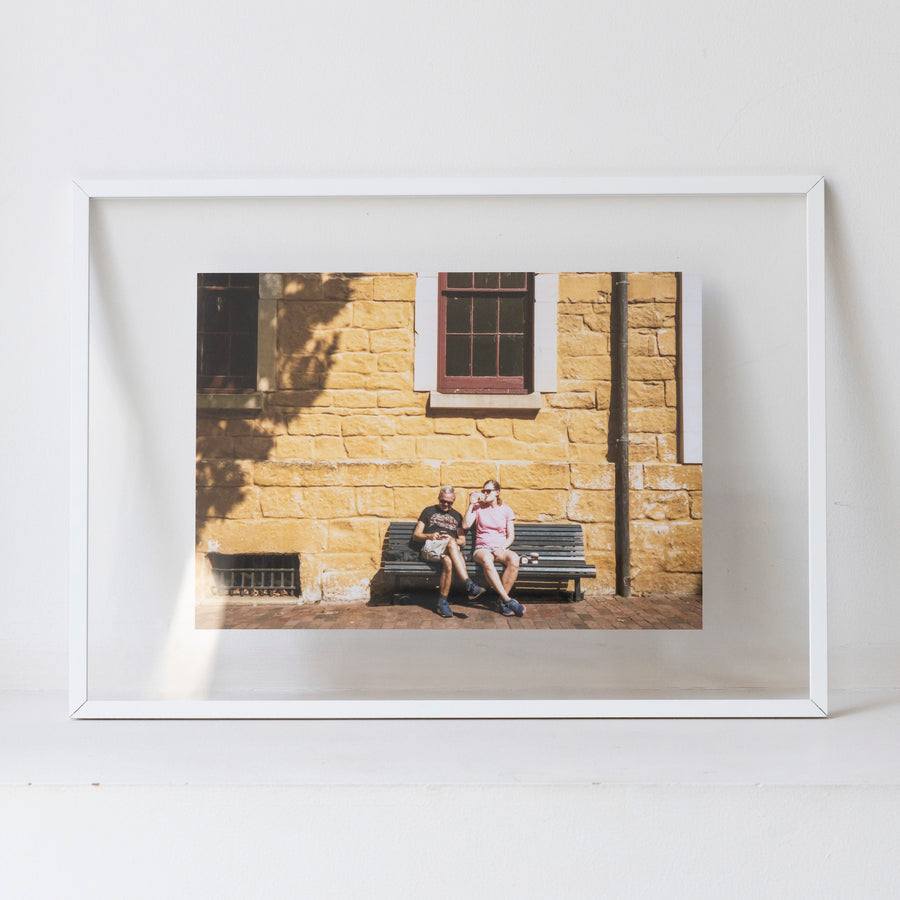 Two people resting on a bench / A3 wh frame